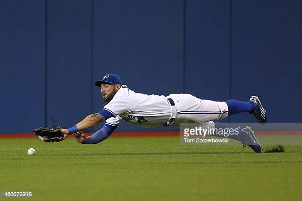 Kevin Pillar of the Toronto Blue Jays dives but cannot get to an RBI double hit by Danny Valencia of the Oakland Athletics in the first inning during...