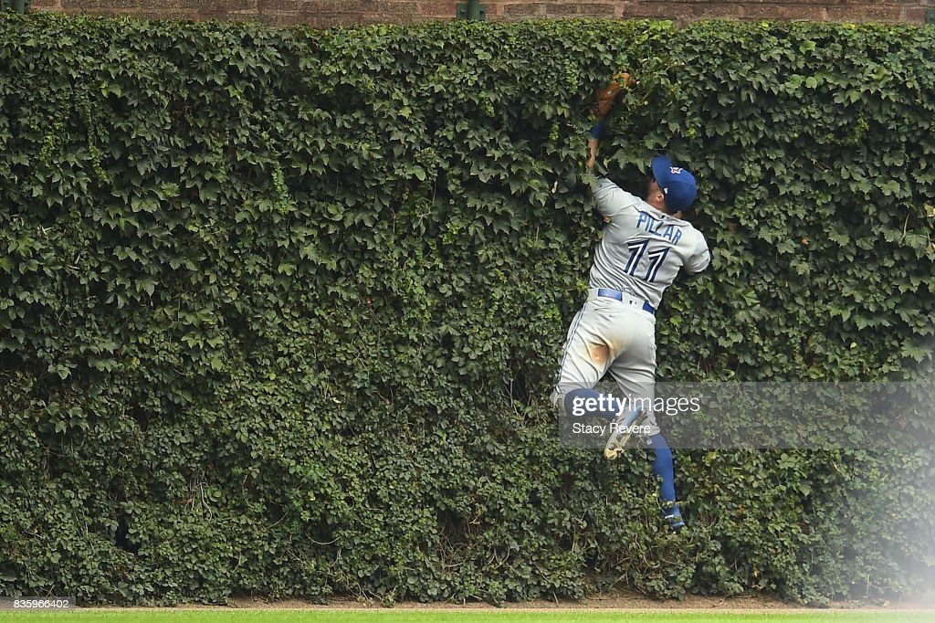 Kevin Pillar #11 of the Toronto Blue Jays fields a fly ball off the center field wall during the eighth inning of a game against the Chicago Cubs at Wrigley Field on August 20, 2017 in Chicago, Illinois.