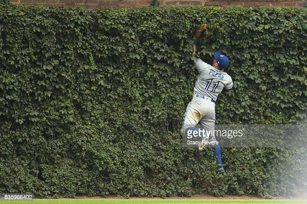 Kevin Pillar of the Toronto Blue Jays fields a fly ball off the center field wall during the eighth inning of a game against the Chicago Cubs at...