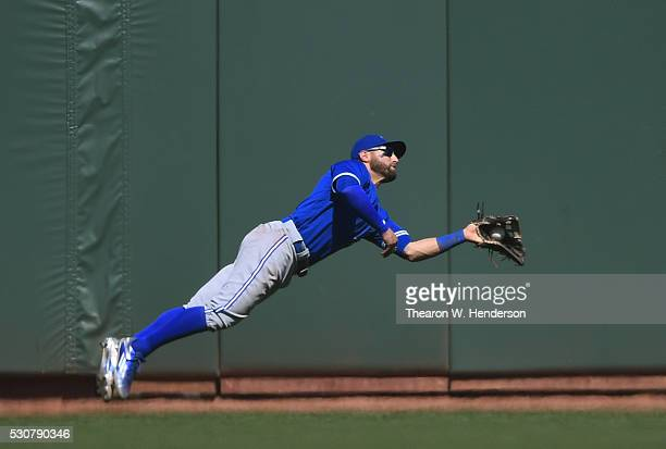 Kevin Pillar of the Toronto Blue Jays has to dive to catch this fly ball off the bat of Joe Panik of the San Francisco Giants in the bottom of the...