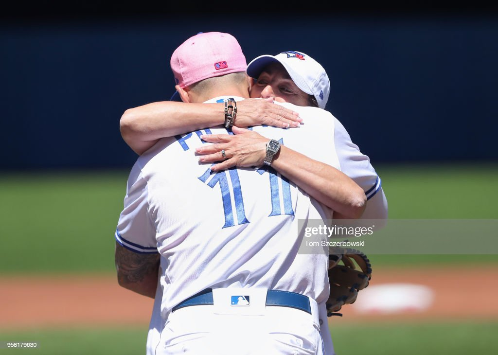 Kevin Pillar #11 of the Toronto Blue Jays hugs his mother Wendy Pillar after she threw out the first pitch before the start of MLB game action against the Boston Red Sox at Rogers Centre on May 13, 2018 in Toronto, Canada.