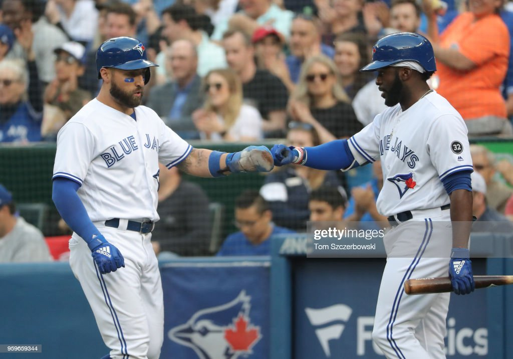 Kevin Pillar #11 of the Toronto Blue Jays is congratulated by Dwight Smith Jr. #27 after scoring a run in the second inning during MLB game action against the Oakland Athletics at Rogers Centre on May 17, 2018 in Toronto, Canada.