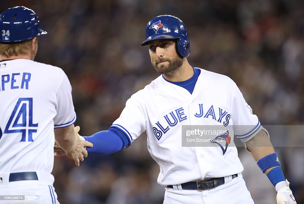 Kevin Pillar #11 of the Toronto Blue Jays is congratulated by first base coach Tim Leiper #34 after hitting an RBI single in the seventh inning during MLB game action against the New York Yankees on May 31, 2016 at Rogers Centre in Toronto, Ontario, Canada.