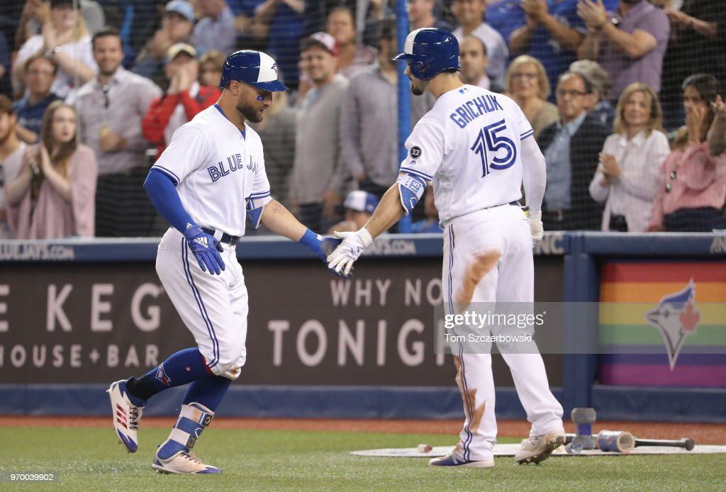 Kevin Pillar #11 of the Toronto Blue Jays is congratulated by Randal Grichuk #15 after hitting a solo home run in the eighth inning during MLB game action against the Baltimore Orioles at Rogers Centre on June 8, 2018 in Toronto, Canada.
