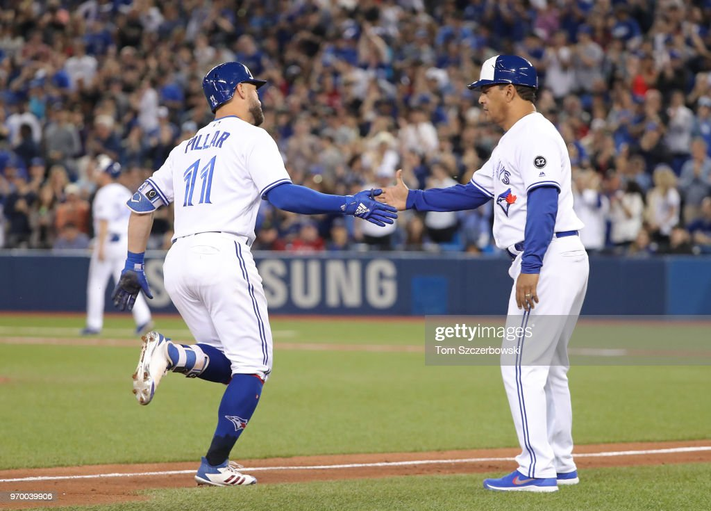 Kevin Pillar #11 of the Toronto Blue Jays is congratulated by third base coach Luis Rivera #4 after hitting a solo home run in the eighth inning during MLB game action against the Baltimore Orioles at Rogers Centre on June 8, 2018 in Toronto, Canada.