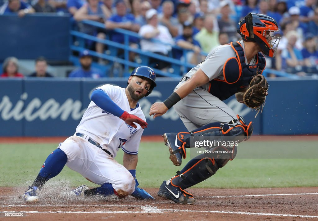 Kevin Pillar #11 of the Toronto Blue Jays is forced out at home plate in the fourth inning during MLB game action as James McCann #34 of the Detroit Tigers records the putout at Rogers Centre on June 29, 2018 in Toronto, Canada.