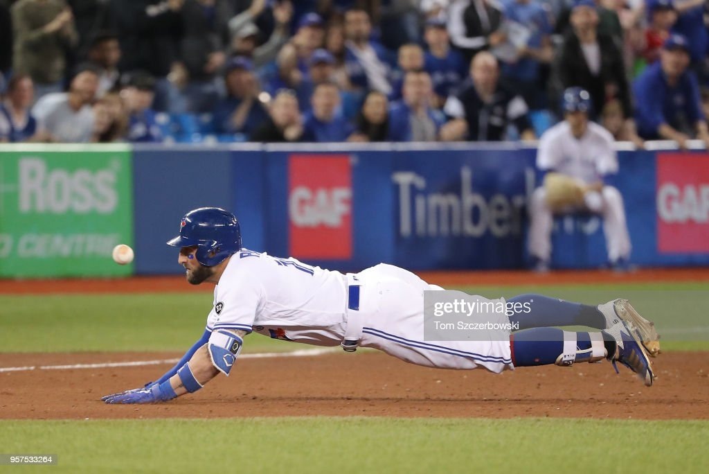 Kevin Pillar #11 of the Toronto Blue Jays is thrown out at third base as he tries to stretch a double into a triple in the ninth inning during MLB game action against the Boston Red Sox at Rogers Centre on May 11, 2018 in Toronto, Canada.