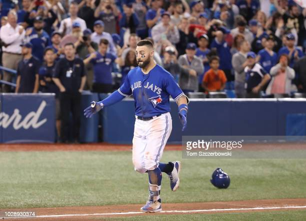 Kevin Pillar of the Toronto Blue Jays jogs home after hitting a gamewinning solo home run in the eleventh inning during MLB game action against the...