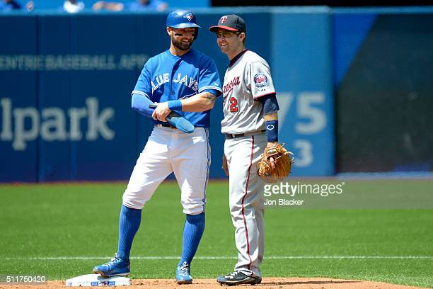 Kevin Pillar of the Toronto Blue Jays laughs with Brian Dozier of the Minnesota Twins during the game against the at the Rogers Centre on Monday...