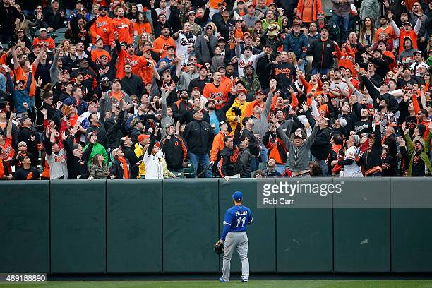 Kevin Pillar of the Toronto Blue Jays looks on as fans cheer a home run hit by Adam Jones of the Baltimore Orioles in the first inning during the...