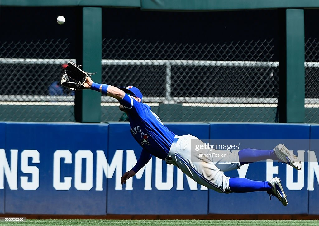 Kevin Pillar #11 of the Toronto Blue Jays makes a catch in center field of the ball hit by Brian Dozier of the Minnesota Twins during the fifth inning of the game on May 22, 2016 at Target Field in Minneapolis, Minnesota. The Blue Jays defeated the Twins 3-1.