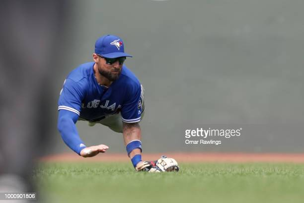 Kevin Pillar of the Toronto Blue Jays makes a diving catch in the bottom of the third inning of the game against the Boston Red Sox at Fenway Park on...