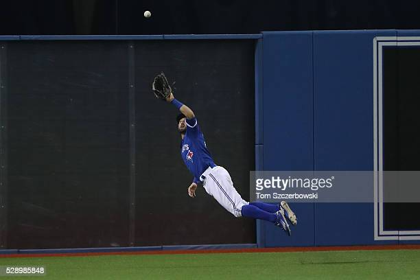 Kevin Pillar of the Toronto Blue Jays makes a diving catch in the ninth inning during MLB game action against the Los Angeles Dodgers on May 7 2016...