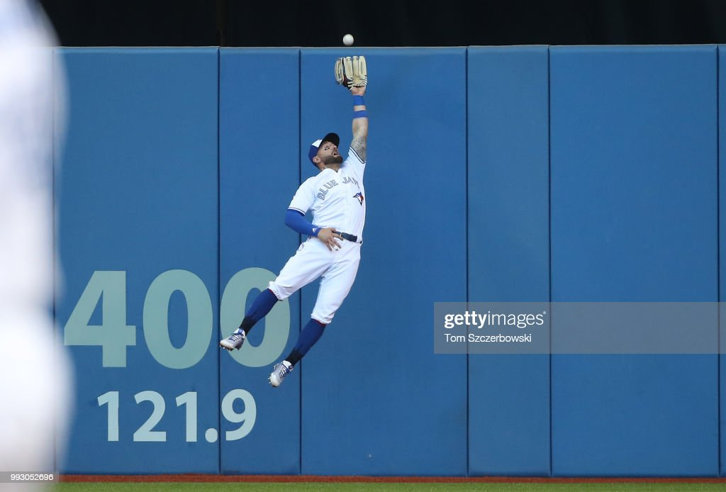 Kevin Pillar #11 of the Toronto Blue Jays makes a leaping catch against the wall in the second inning during MLB game action against the New York Yankees at Rogers Centre on July 6, 2018 in Toronto, Canada.