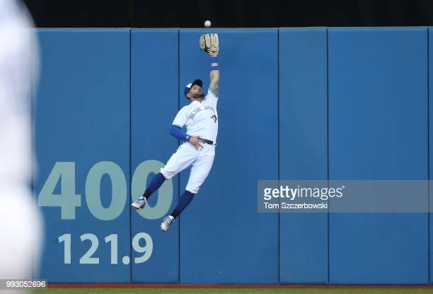 Kevin Pillar of the Toronto Blue Jays makes a leaping catch against the wall in the second inning during MLB game action against the New York Yankees...