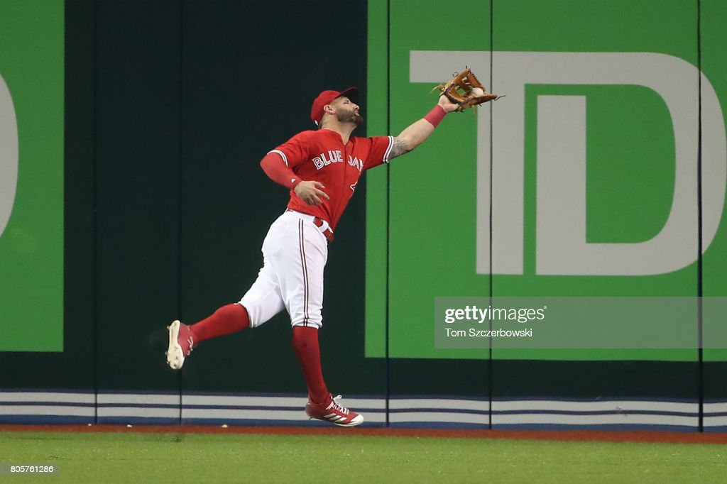 Kevin Pillar #11 of the Toronto Blue Jays makes a running catch in the ninth inning during MLB game action against the Boston Red Sox at Rogers Centre on July 2, 2017 in Toronto, Canada.