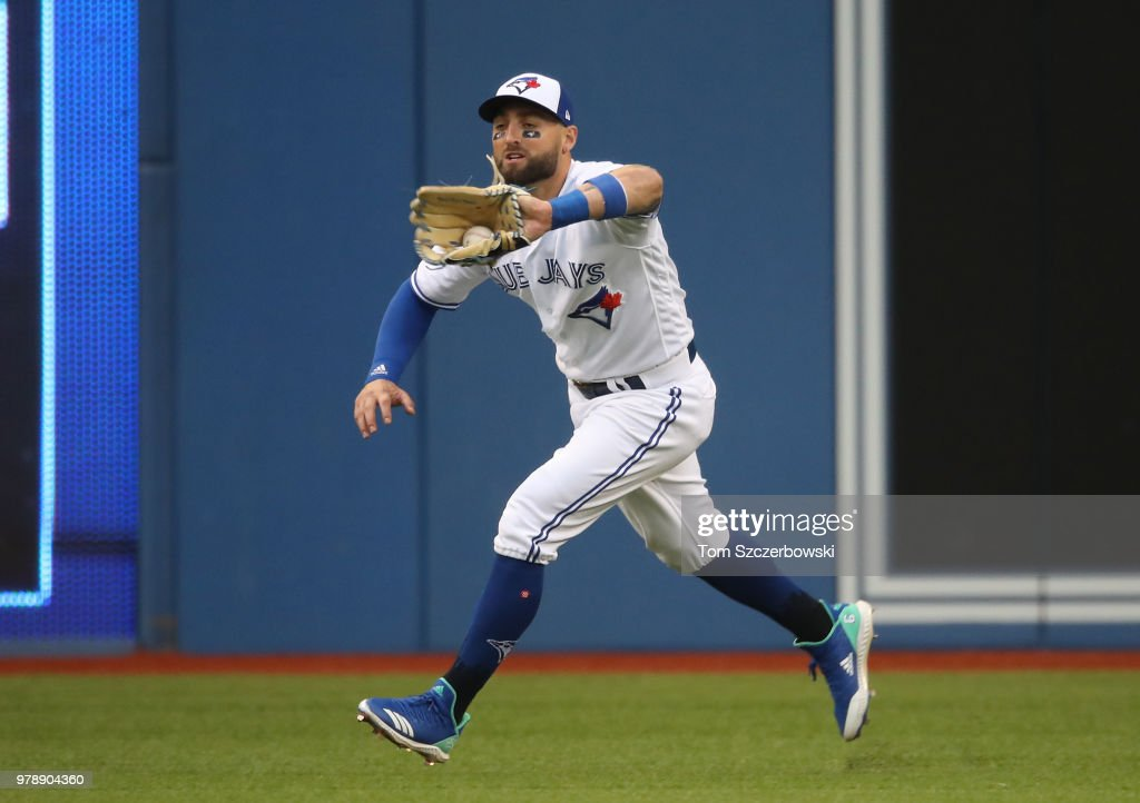 Kevin Pillar #11 of the Toronto Blue Jays makes a running catch in the third inning during MLB game action against the Atlanta Braves at Rogers Centre on June 19, 2018 in Toronto, Canada.