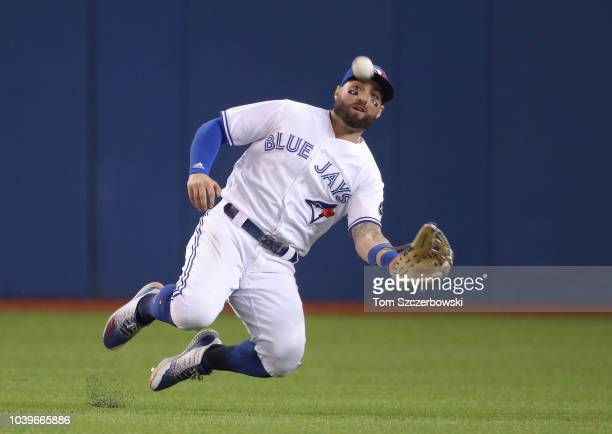Kevin Pillar of the Toronto Blue Jays makes a sliding catch in the eighth inning during MLB game action against the Houston Astros at Rogers Centre...