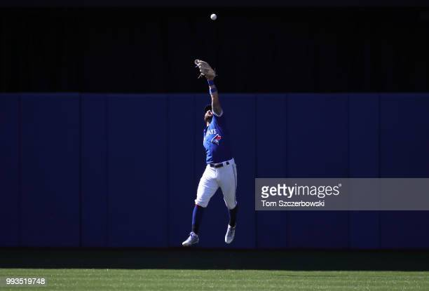 Kevin Pillar of the Toronto Blue Jays overruns a double hit by Brandon Drury of the New York Yankees in the first inning during MLB game action at...