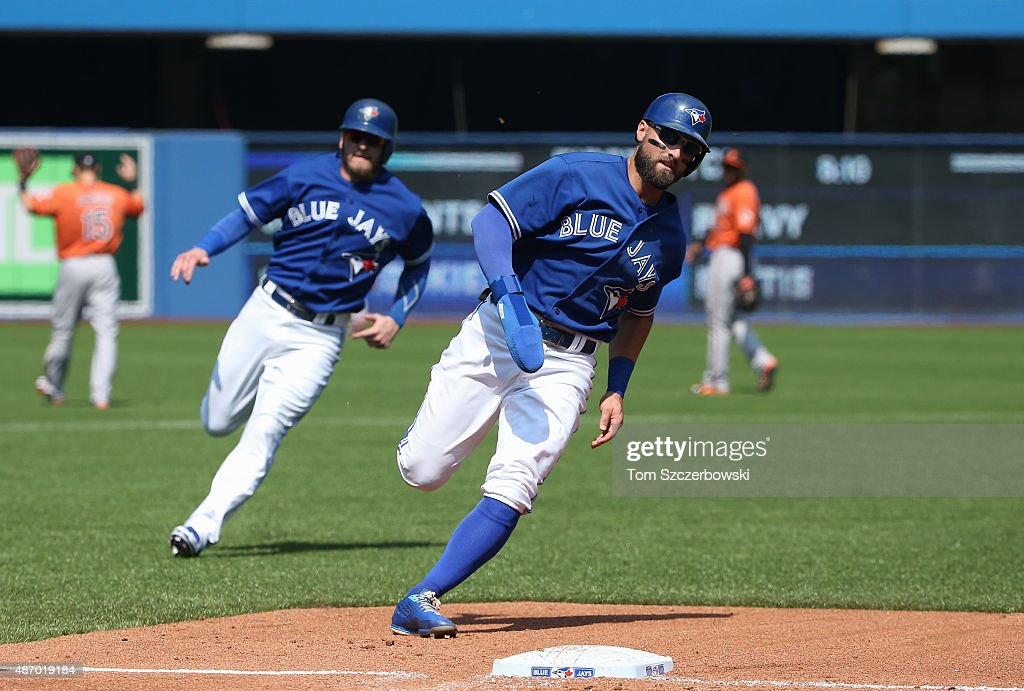 Kevin Pillar #11 of the Toronto Blue Jays races home to score on an RBI double by Jose Bautista #19 as Josh Donaldson #20 runs to third base right behind him in the third inning during MLB game action against the Baltimore Orioles on September 5, 2015 at Rogers Centre in Toronto, Ontario, Canada.