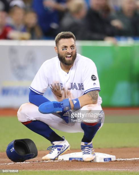Kevin Pillar of the Toronto Blue Jays rests and waits on third base during a coaching visit to the mound in the tenth inning during MLB game action...