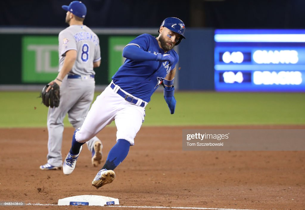 Kevin Pillar #11 of the Toronto Blue Jays rounds third base and runs home to score a run in the fifth inning during MLB game action against the Kansas City Royals at Rogers Centre on April 18, 2018 in Toronto, Canada.