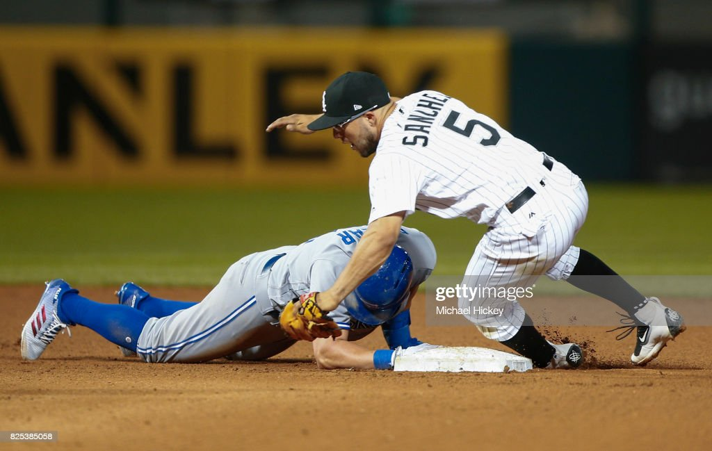 Kevin Pillar #11 of the Toronto Blue Jays safely reaches second base as Yolmer Sanchez #5 of the Chicago White Sox attempts the tag at Guaranteed Rate Field on August 1, 2017 in Chicago, Illinois.