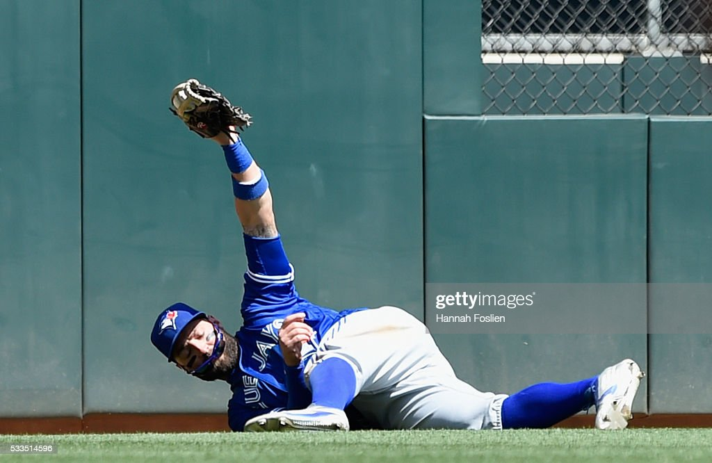 Kevin Pillar #11 of the Toronto Blue Jays shows that he caught the ball hit by Brian Dozier #2 of the Minnesota Twins in center field during the fifth inning of the game on May 22, 2016 at Target Field in Minneapolis, Minnesota. The Blue Jays defeated the Twins 3-1.