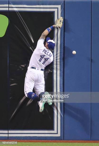 Kevin Pillar of the Toronto Blue Jays slams into the wall but cannot get to a triple hit by Mookie Betts of the Boston Red Sox in the second inning...