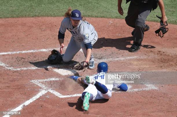 Kevin Pillar of the Toronto Blue Jays slides home safely to score a run in the sixth inning during MLB game action as Ryne Stanek of the Tampa Bay...