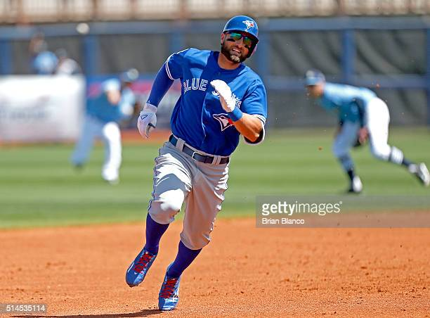 Kevin Pillar of the Toronto Blue Jays sprints toward third base after hitting a triple off of pitcher Chris Archer of the Tampa Bay Rays during the...