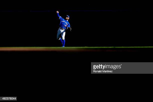 Kevin Pillar of the Toronto Blue Jays throws the ball back after catching a ball hit by Rougned Odor of the Texas Rangers in the fifth inning in game...