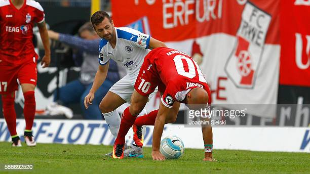 Kevin PiresRodrigues of Lotte challenges Daniel Brueckner of Erfurt during the third league match between SF Lotte and RotWeiss Erfurt at Frimo...