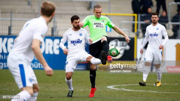 Kevin PiresRodrigues of Lotte challenges Dennis Grote of Chemnitz during the 3 Liga match between Sportfreunde Lotte and Chemnitzer FC at Frimo...
