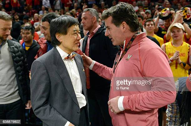 Kevin Plank Under Armour founder and CEO talks with University of Maryland President Wallace Loh before the game between the Maryland Terrapins and...