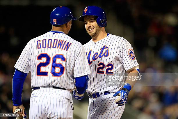 Kevin Plawecki celebrates his first career major league hit with first base coach Tom Goodwin of the New York Mets in the fifth inning against the...