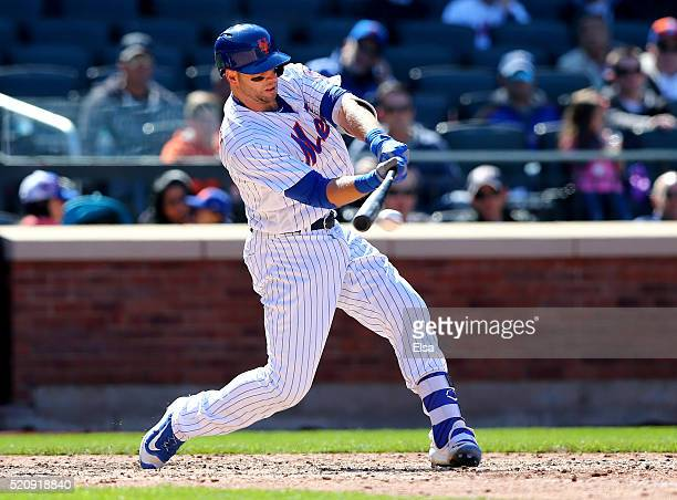 Kevin Plawecki of the New York Mets hits a 2RBI single in the seventh inning against the Miami Marlins at Citi Field on April 13 2016 in the Flushing...