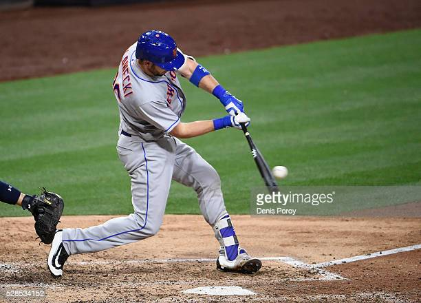 Kevin Plawecki of the New York Mets hits a single during the eighth inning of a baseball game against the San Diego Padres at PETCO Park on May 5...