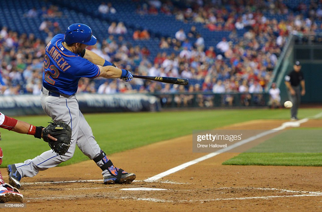 Kevin Plawecki #22 of the New York Mets hits a single in the fourth inning against the Philadelphia Phillies at Citizens Bank Park on May 8, 2015 in Philadelphia, Pennsylvania.