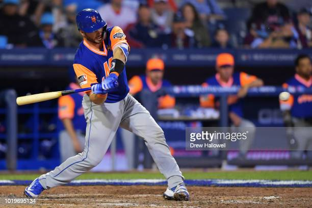 Kevin Plawecki of the New York Mets hits a single in the sixth inning against the Philadelphia Phillies during the inaugural MLB Little League...