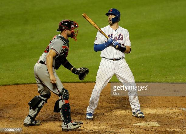 Kevin Plawecki of the New York Mets reacts after he struck out to end the game as Tyler Flowers of the Atlanta Braves celebrates the 42 win on August...