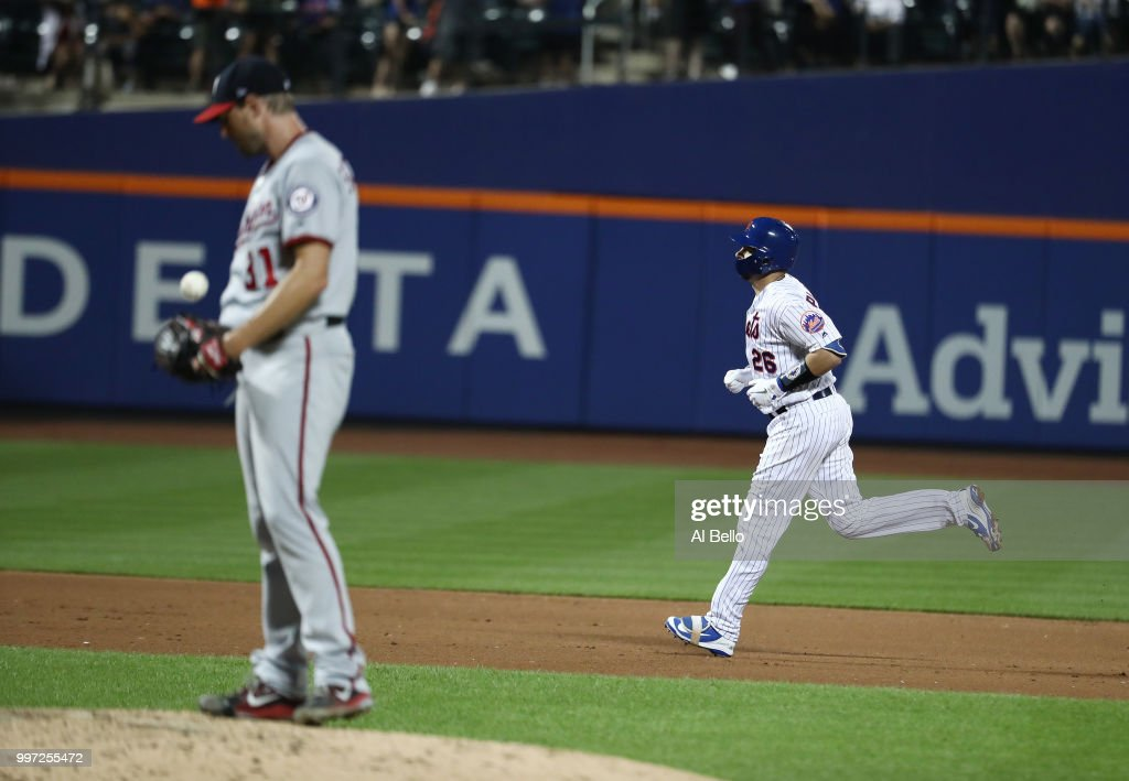 Kevin Plawecki #26 of the New York Mets rounds the bases after hitting a seventh inning home run against Max Scherzer #31 of the Washington Nationals during their game at Citi Field on July 12, 2018 in New York City.