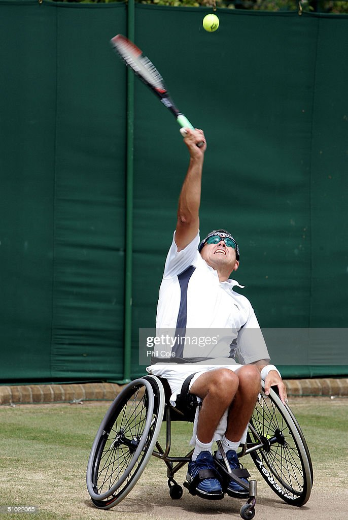 Kevin Plowman of Great Britain in action during his and David Gardner of Great Britain special event first round match against Matt Faucher of Great Britain and John Greer of USA at the Wimbledon Lawn Tennis Championship on July 3, 2004 at the All England Lawn Tennis and Croquet Club in London.