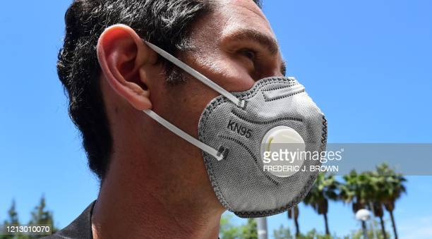 Kevin Pomplun wears an N95 mask with filter on May 14 2020 at the LACUSC Medical Center in Los Angeles California during a delivery of personal...