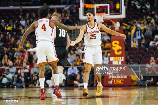 Kevin Porter and Bennie Boatwright of the USC Trojans high five each other in a game against the Colorado Buffaloes at Galen Center on February 09...