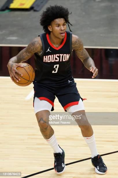 Kevin Porter Jr. #3 of the Houston Rockets dribbles against the Miami Heat during the second quarter at American Airlines Arena on April 19, 2021 in...