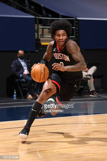 Kevin Porter Jr. #3 of the Houston Rockets dribbles the ball during the game against the Minnesota Timberwolves on March 27, 2021 at Target Center in...