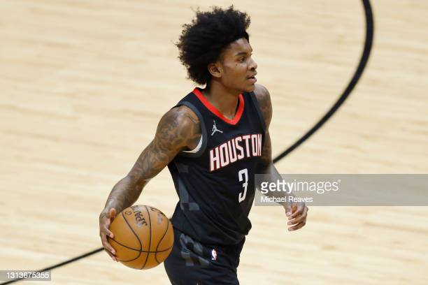 Kevin Porter Jr. #3 of the Houston Rockets in action against the Miami Heat during the first quarter at American Airlines Arena on April 19, 2021 in...