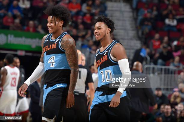 Kevin Porter Jr. #4 of the Cleveland Cavaliers and Darius Garland of the Cleveland Cavaliers smiles during the game against the Houston Rockets on...