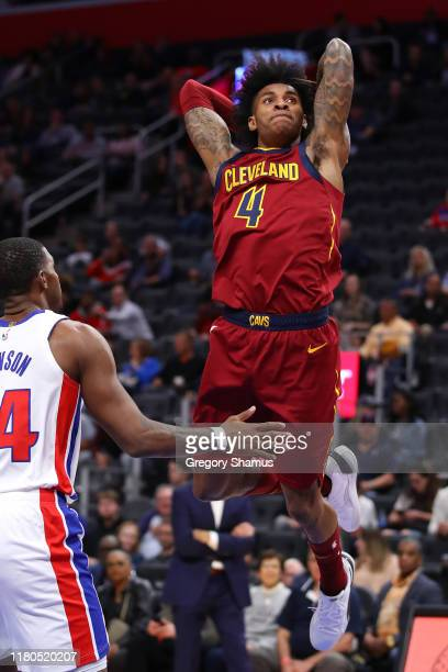 Kevin Porter Jr. #4 of the Cleveland Cavaliers dunks in the second half next to Joe Johnson of the Detroit Pistons at Little Caesars Arena on October...